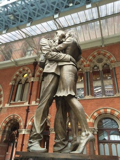 The Meeting Place by Paul Day inside Saint Pancras International Station, London, United Kingdom Architecture Art And Craft Built Structure Human Representation Low Angle View Railway Station Saint Pancras Sculpture St Pancras St Pancras International St Pancras Station Statue Train Station