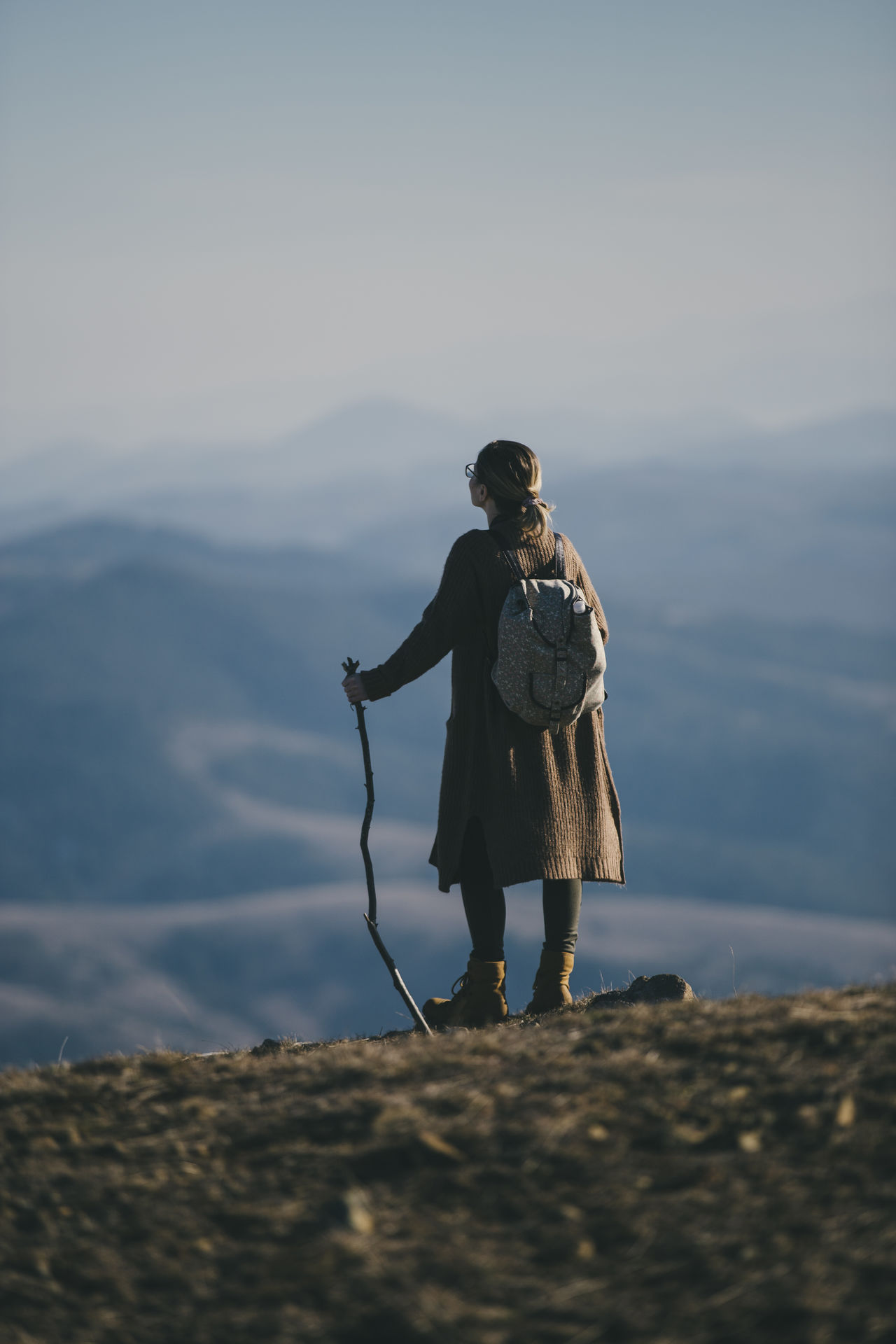 Rear view of woman hiking on mountain