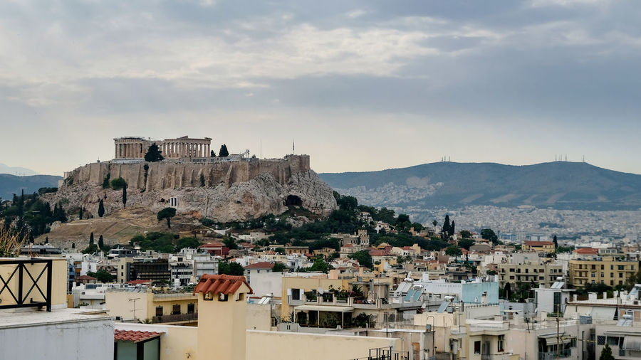 The Acropolis & Parthenon Neighborhood, Athens, Greece. Acropolis, Athens Athens, Greece Athens Historical Place Historical Building Parthenon Acropolis Greece Parthenon Acropolis Landmark TOWNSCAPE Outdoors Cityscape History The Past Mountain Range Travel Destinations Cloud - Sky Residential District City Sky Mountain Building Built Structure Building Exterior Architecture Nature Town Crowded House Day Community