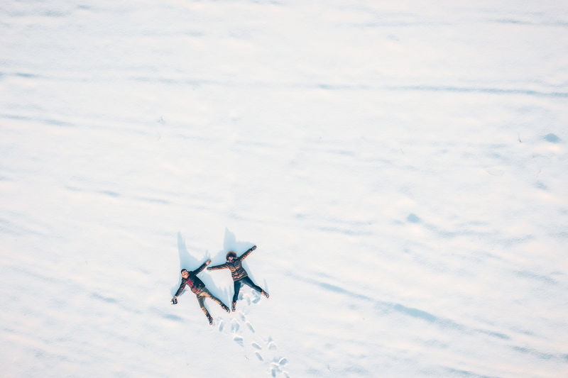 Winter fun Mavic Pro Mavic 2 Pro Aerial View Aerial Winter Winter Wonderland Birds Eye View DJI X Eyeem Drone  Winter Fun Lying On Snow Lying Snow People Two People Couple Cold Temperature Nature White Color Frozen Outdoors Covering Field Beauty In Nature