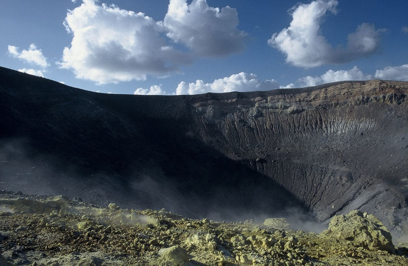 Scenic View Of A Caldera Against Cloudy Sky