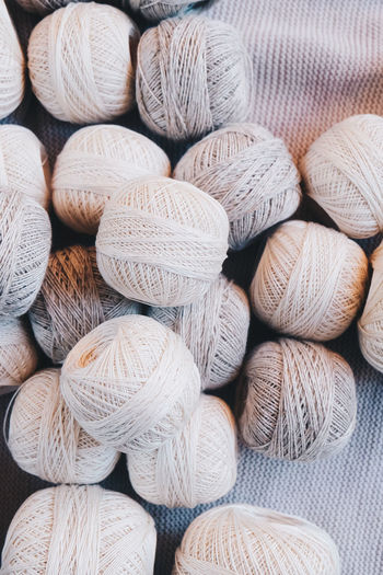 Textile Still Life No People Close-up Backgrounds Full Frame Large Group Of Objects Arrangement Abundance Wool Choice Variation Pattern Textured  Softness Indoors  Art And Craft Stack Material Collection Neutral Colors Yarn Yarn Balls Cotton Cotton Balls Strings