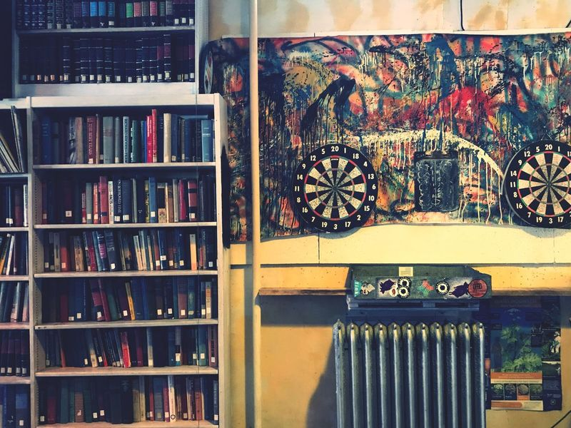 Beers, books & darts 🎯 Book Bookshelf Shelf Large Group Of Objects Indoors  Built Structure No People Day Architecture Geneva SenecaLake Sommergefühle