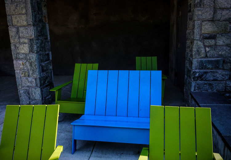 Wooden chairs Blue Architecture Wood - Material No People Built Structure Green Color Wall - Building Feature Day Multi Colored Seat Outdoors Empty Entrance Nature Wall Door Striped Protection Chairs Outdoor Furniture Deck Chairs Wooden Chairs Alcoves
