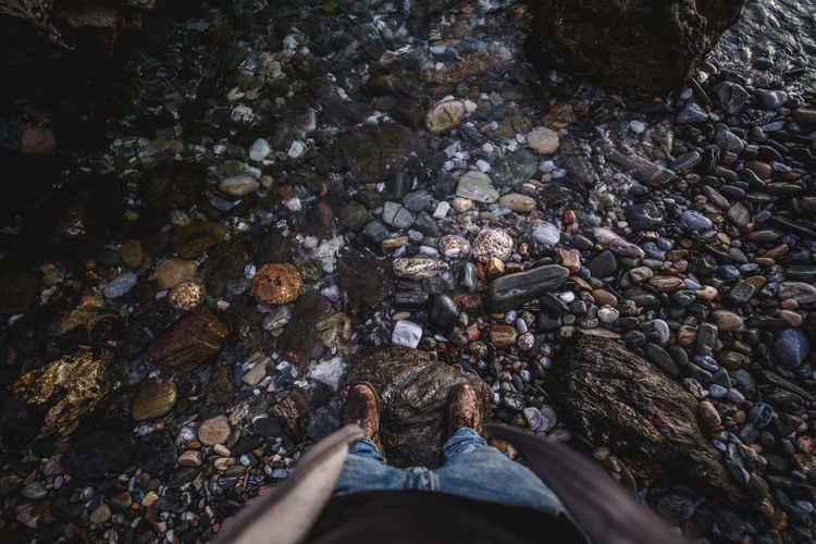 Rock Solid Rock - Object Lifestyles Water Nature Outdoors Men High Angle View Adult Stone - Object People Adventure Shoes Rocks And Water Water Background From Above  Foot First Eyeem Photo