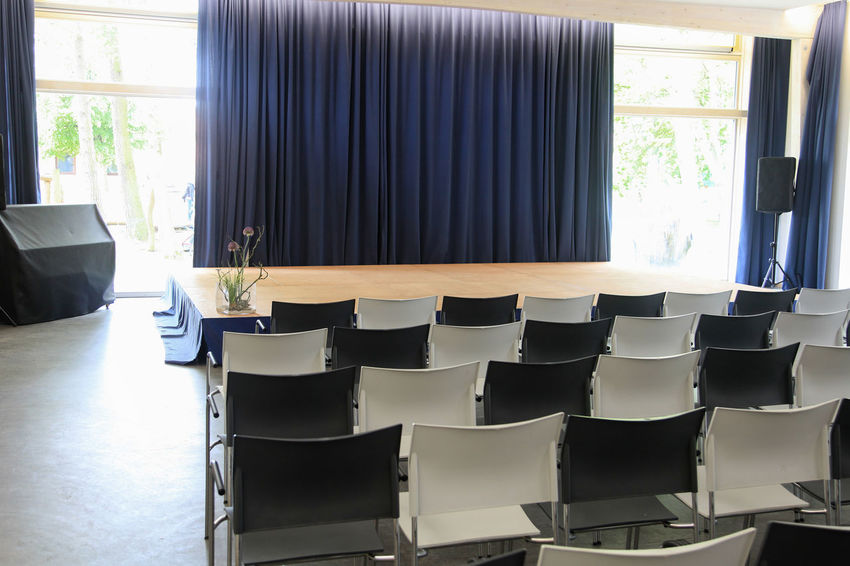 Stage with chairs and curtain Empty Chair Event Show Stage Theater Absence Audience Black Color Chair Concert Culture Curtain Education Empty Entertainment Furniture In A Row Indoors  Large Group Of Objects No People Performance Presentation Seat Side By Side Window