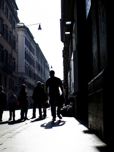Architecture Building Exterior Built Structure Street City Real People Walking Building Full Length Men Lifestyles Nature Day Rear View City Life Silhouette Outdoors Contrast Streetphotography