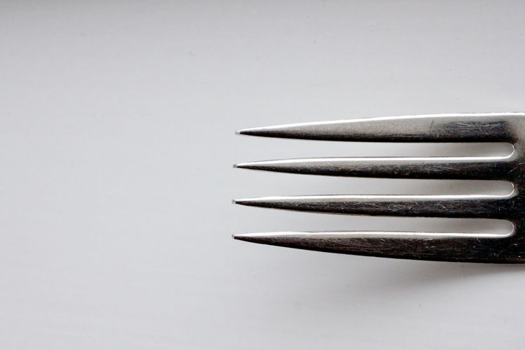 Studio Shot Indoors  White Background Copy Space No People Still Life Gray Close-up In A Row Silver - Metal Silver Colored Single Object Shadow Fork Macro