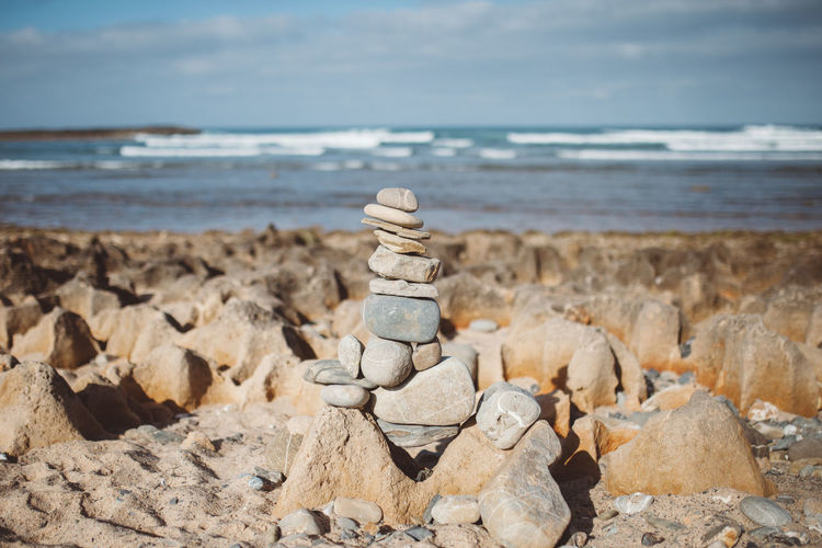 Art And Craft Balanced Balanced Rock Balanced Stones Beach Beauty In Nature Close-up Day Equilibrium Horizon Over Water Nature No People Outdoors Rock - Object Scenics Sea Sky Stack Statue Stone Stones Sunlight Tranquil Scene Tranquility Water
