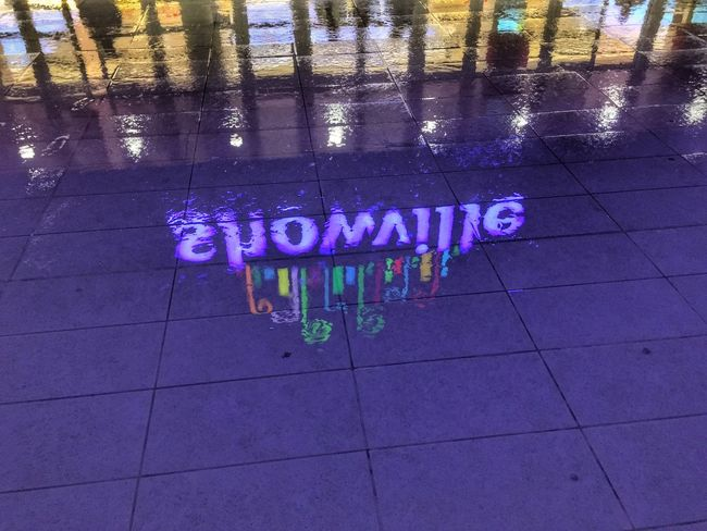 Reflections Text Communication Western Script City No People Day HUAWEI Photo Award: After Dark Architecture Street Purple Pink Color Outdoors Footpath Tile Multi Colored Sign Built Structure Nature Creativity Water Flooring