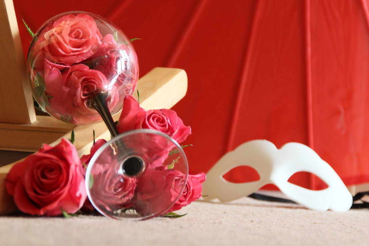 red, rose - flower, flower, petal, heart shape, love, rose petals, no people, celebration, flower head, wedding, ribbon - sewing item, close-up, indoors, day, nature, fragility, freshness