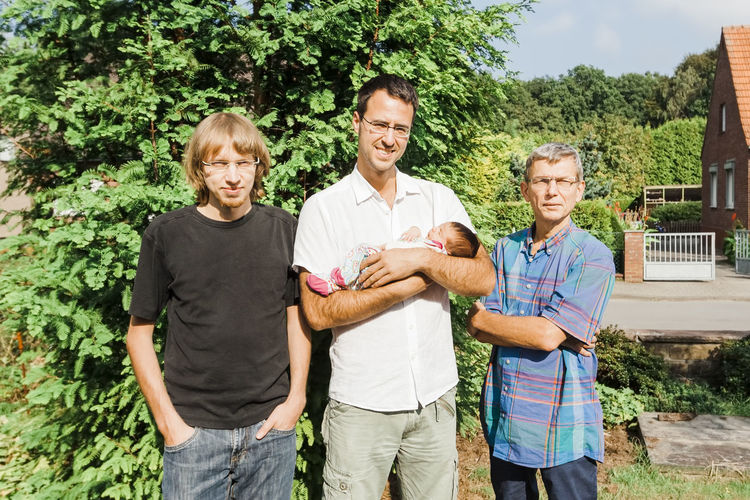 Portrait of family standing against plants