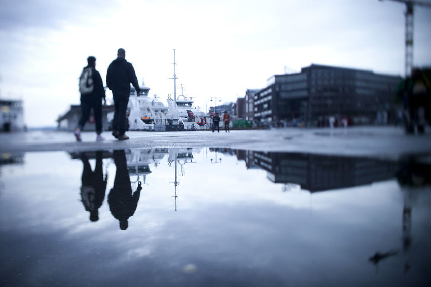 Couple walking along Oslo Harbor (Norway). Blue tones. Horizontal format. Adult Architecture Blue Bluish Boat City Cityscape Cold Colors Day Harbor Melancholic Landscapes No People Oslo Outdoors People Real People Reflection Sky Unrecognizable People Vignette Walking Water Waterfront Winter