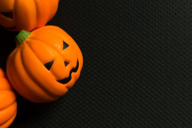 Close-up of pumpkin on orange surface