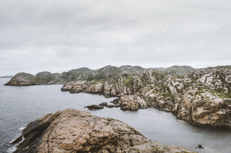 Lindesnes, Norway Atlantic Ocean Fyr Landscape_Collection Lighthouse Lindesnes Lindesnes Fyr Moody Sky Nature Norway Norway🇳🇴 Beauty In Nature Day Fjord Landscape Mood Mountain Nature No People Northsea Outdoors Rock - Object Scenics Sea Sky Stone Tranquil Scene Tranquility Water