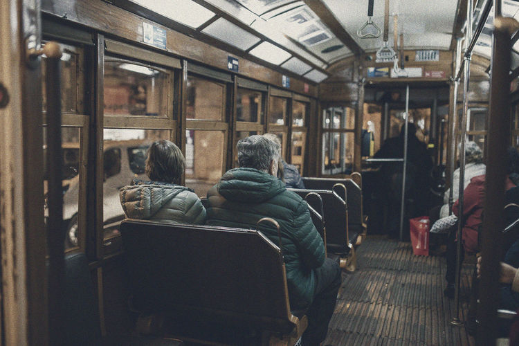 Chair Day Indoors  Men Passenger People Public Transportation Rail Transportation Real People Rear View Sitting Togetherness Train - Vehicle Train Interior Transportation Vehicle Seat Women