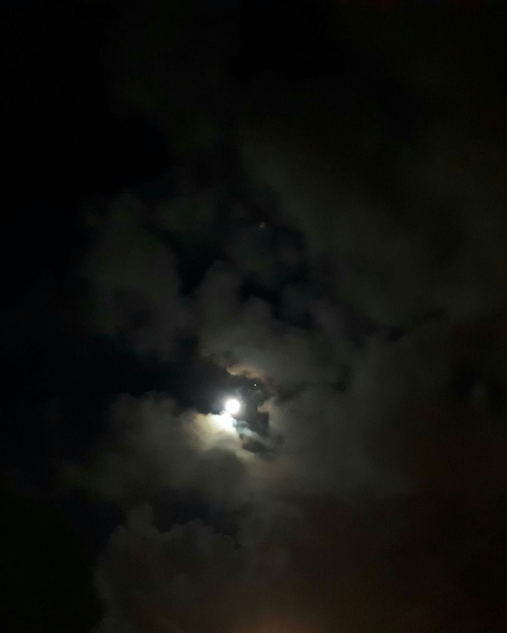 night, cloud - sky, moon, sky, nature, dark, low angle view, beauty in nature, scenics, sky only, no people, outdoors, storm cloud, illuminated, astronomy