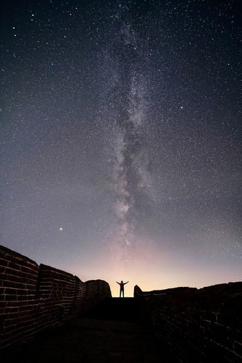 Silhouette man against star field at night