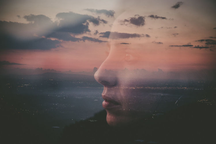 Multiple exposure of woman against sky during sunset