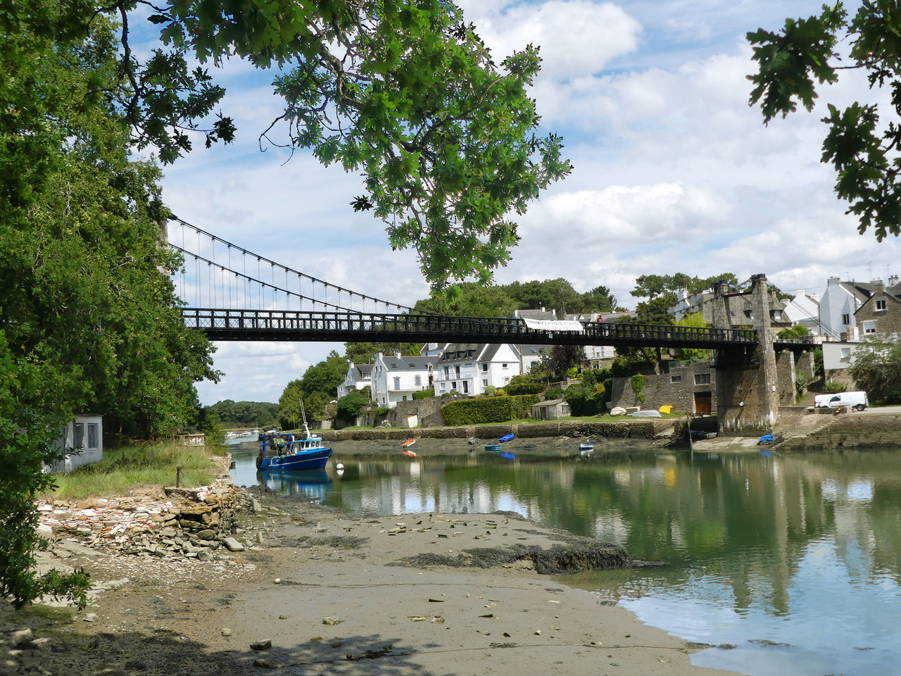 water, built structure, architecture, bridge, connection, sky, cloud - sky, bridge - man made structure, transportation, tree, river, plant, nature, day, reflection, engineering, building exterior, outdoors, arch bridge