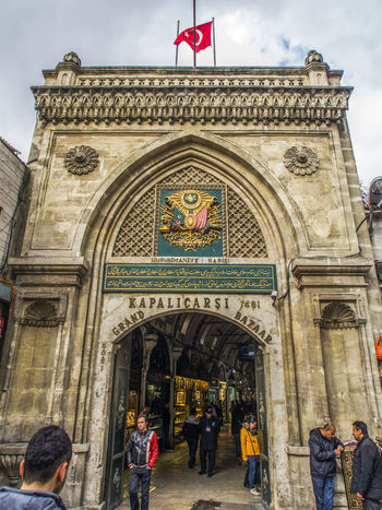 Entrance to the Grand Bazaar Arch Architectural Feature Architecture Art Art And Craft Building Exterior Built Structure Carving - Craft Product Creativity Entrance Entrance Façade Famous Place Gate Grand Bazaar History Human Representation Lifestyles Men Person Sculpture Statue Tourism Tourist Vacations