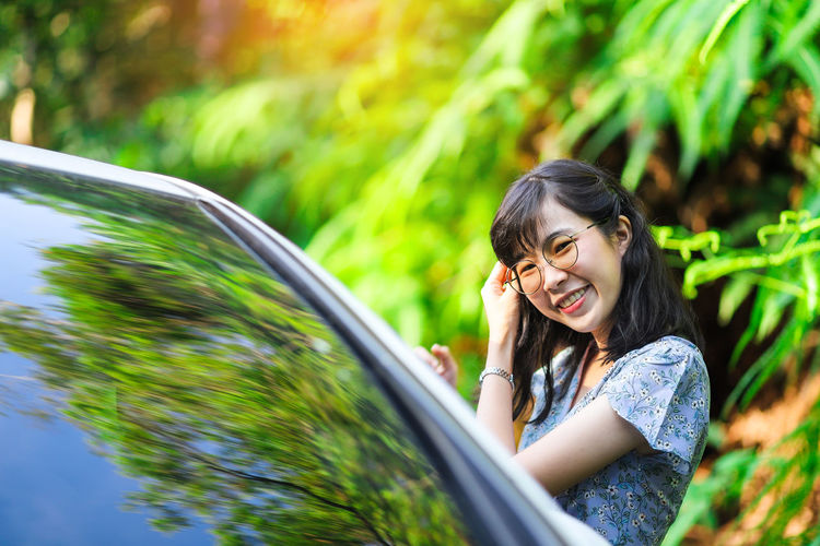 Vacation time in Khao Yai National Park Car Smiling Motor Vehicle Happiness Transportation Women Lifestyles Leisure Activity Hairstyle Hair Outdoors Fern Leaf Nature Green Plant Woman Girl Travel Beautiful Park Thailand Thai Woman Khao Yai National Park Big Mountain
