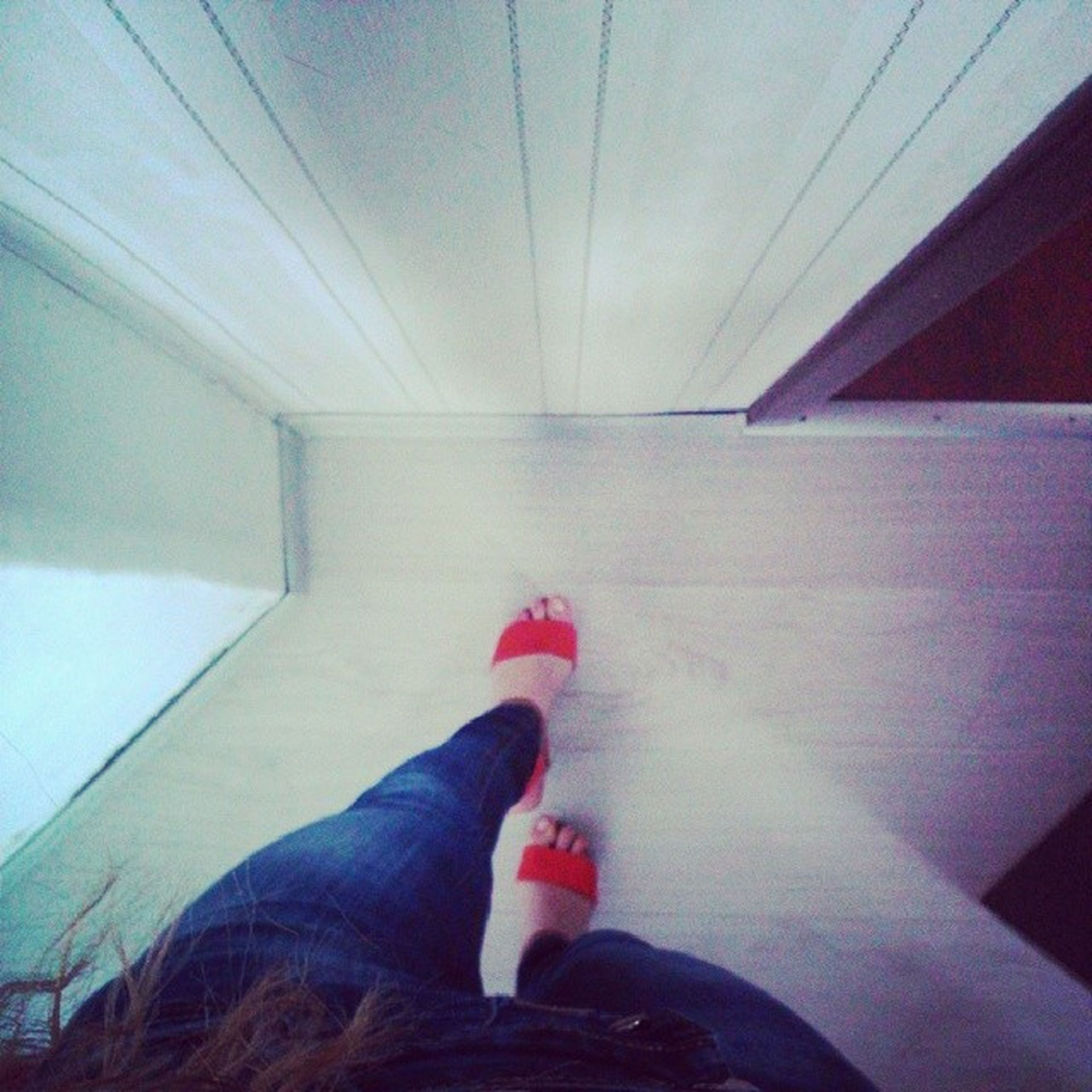 indoors, low section, person, lifestyles, built structure, architecture, leisure activity, ceiling, sunlight, blue, red, high angle view, modern, day, human foot, standing, flooring
