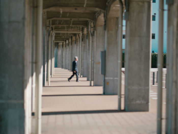 Architecture Built Structure Architectural Column Arcade One Person Corridor Day Full Length The Way Forward Building Arch In A Row Real People Walking Building Exterior Direction Colonnade History The Past The Street Photographer - 2019 EyeEm Awards My Best Photo