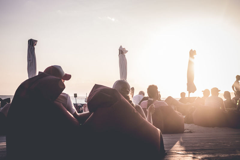 Communication Enjoyment Happiness Lifestyles People Relaxation Sunlight Sunset Togetherness Vacations Warm Atmosphere Watching The Sunset Young Adult Young Women