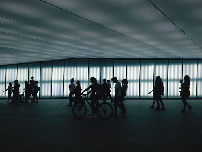 Full Length Of People Walking Underground