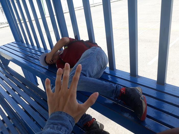 High Angle View Of Man Lying On Bench