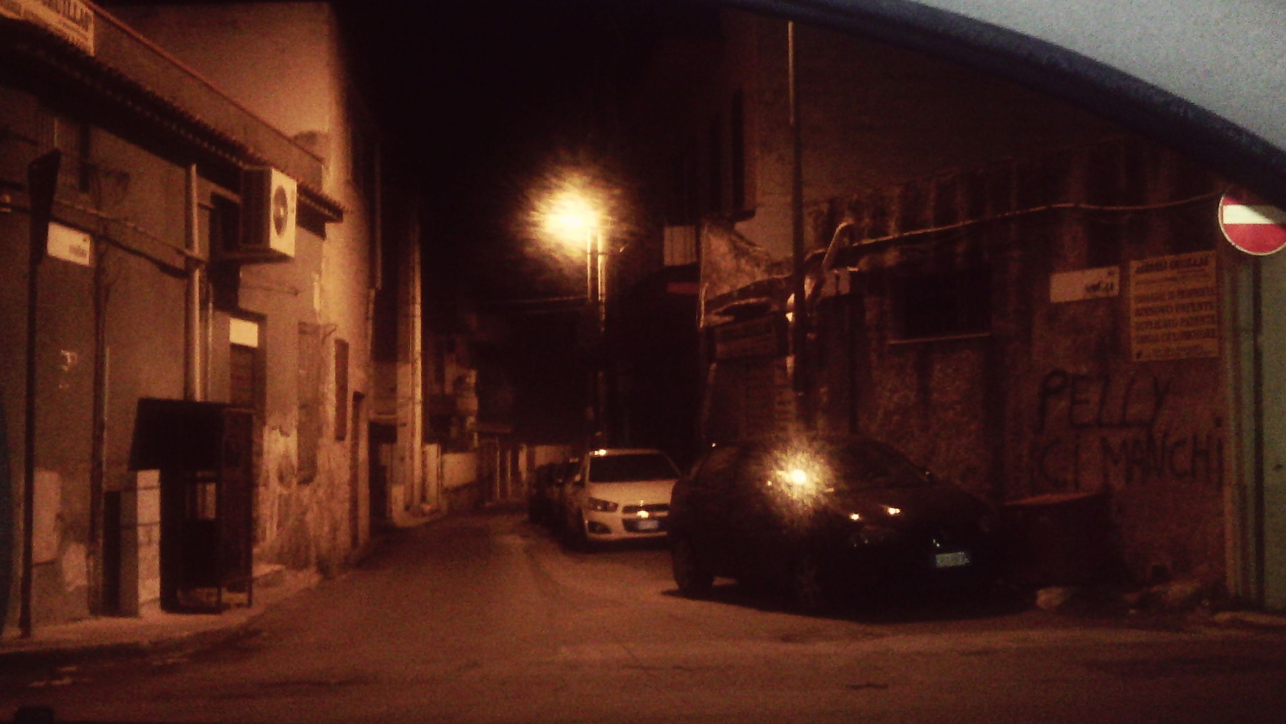 architecture, built structure, illuminated, the way forward, night, building exterior, transportation, street, road, diminishing perspective, street light, building, city, vanishing point, lighting equipment, car, land vehicle, outdoors, no people, tunnel
