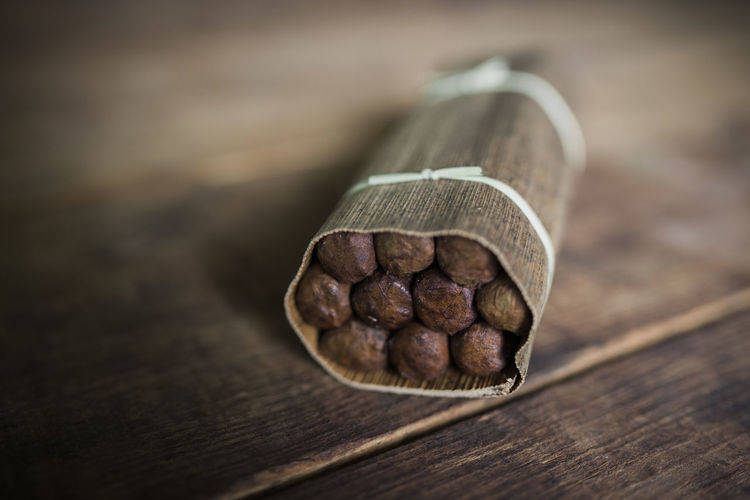 Brown Cigar Cigarette  Cigars Close-up Focus On Foreground Handmade Indoors  No People Palm Leaf Palmleaf Robaina Selective Focus Smoking Still Life Tabaco Table Wood - Material