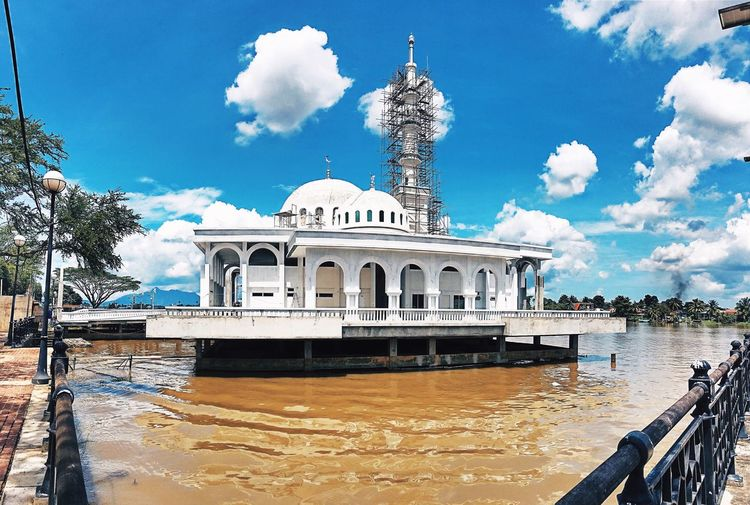 Mosque Architecture Architecture Building Exterior Built Structure Sky Cloud - Sky Nature Water Day Building Travel Incidental People Travel Destinations Beach City History The Past Tree Sunlight Outdoors Dome