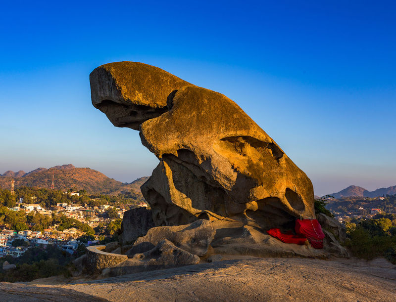 Toad looking figure in this image is a stone structure on mountain in Mount Abu of Rajasthan. According to old Indian stories, toad calls god of rain. Hill Station India Scenic Toad Looking Figure Tourist Attraction  Beauty In Nature Blue Sky Eroded Landscape Mount Abu Rajasthan, India Mountain Nature No People Outdoor Photography Outdoors Rajasthan Rock Rock - Object Rock Formation Scenics - Nature Sky Sunlight Tourist Destination Tranquil Scene Travel Destinations