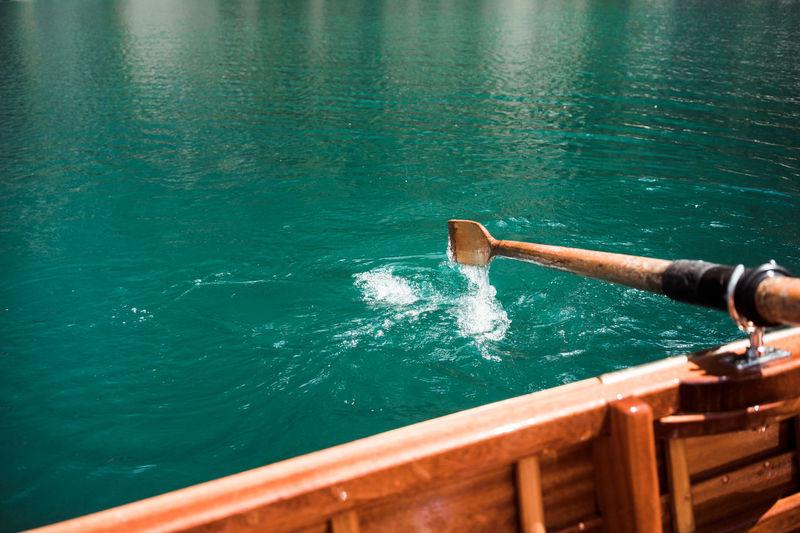 Boat and oar on sea