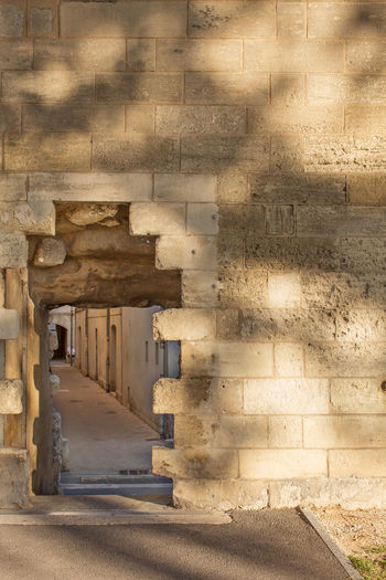An entrance in surrounding wall in Avignon, France Ancient Architecture Avignon Building Built Structure Day Entrance Historic No People Old Outdoors Shadows & Lights Stone Wall Sunlight Surrounding Wall The Way Forward Travel Destination Vanishing Point Fantastic Exhibition First Eyeem Photo The Places I've Been Today Work Working-class Check This Out