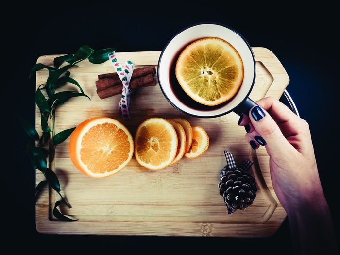 High angle view of orange slices and black tea