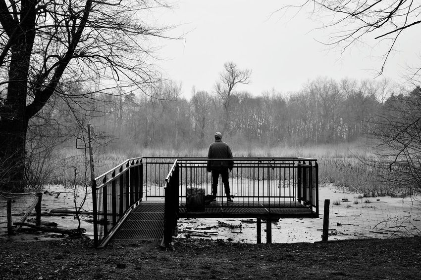 Alone Time Alone Thinking About Life Have A Break Relaxing Meditation Innercircle Light And Shadow Blancoynegro Blanco Y Negro Bnw Noir Et Blanc Bnw_friday_eyeemchallenge Berlin Schwarzweiß Blackandwhite Black And White This Is Masculinity Tree Water Full Length Fog Railing Bridge - Man Made Structure Sky Observation Point Lookout Tower Fence Footbridge