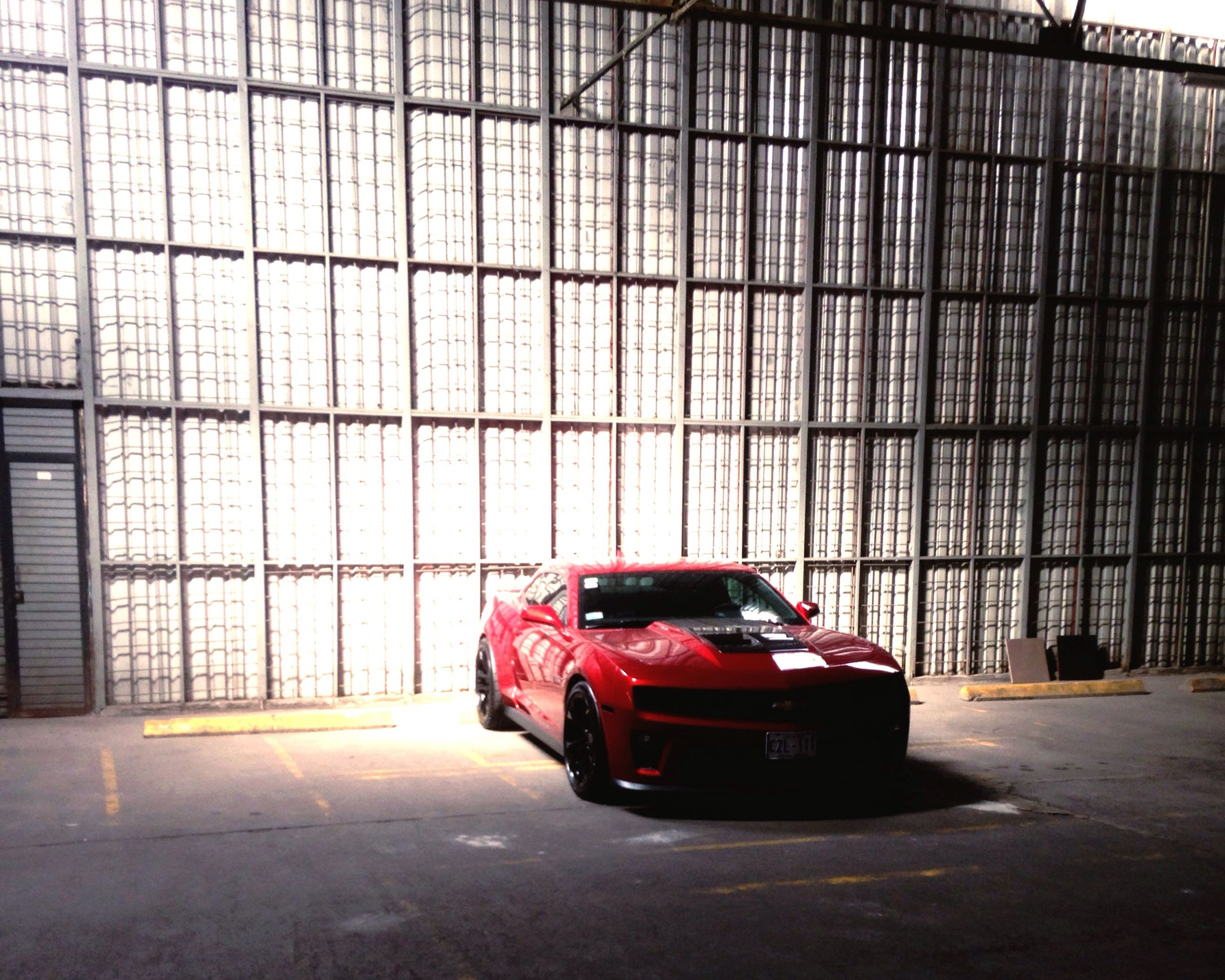 car, transportation, red, land vehicle, stationary, no people, day, indoors, nature
