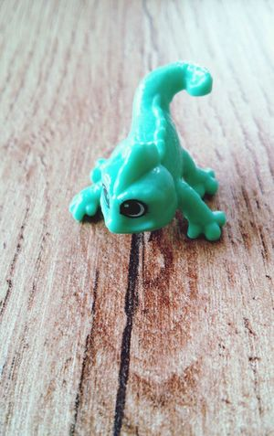 Leguan on Wood #EyeEmNewHere Leguan Surprise Egg EyeEm Selects Animal Representation Toy High Angle View Green Color Figurine  Wood - Material