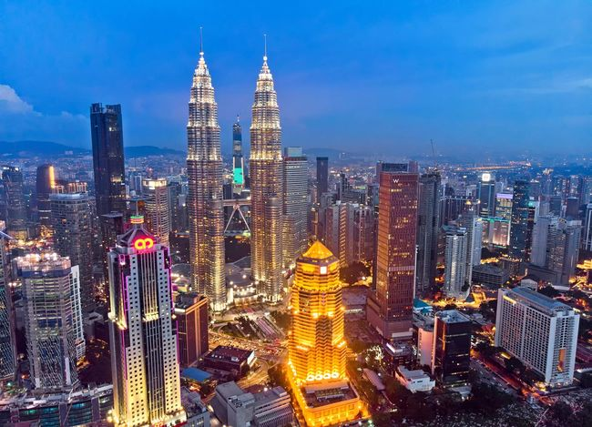 Kuala Lumpur cityscape during blue hour Sunset Sky And Clouds Aerial Shot Aerial Photography Drone  Dronephotography Beautiful Landscape Beauty Travel Destinations Travel EyeEm Selects Getty Images EyeEm Best Shots Malaysia Skyline Outdoor City Cityscape Urban Skyline Illuminated Modern Skyscraper Futuristic Aerial View Office Building Exterior Tower Office Building Financial District  Downtown District