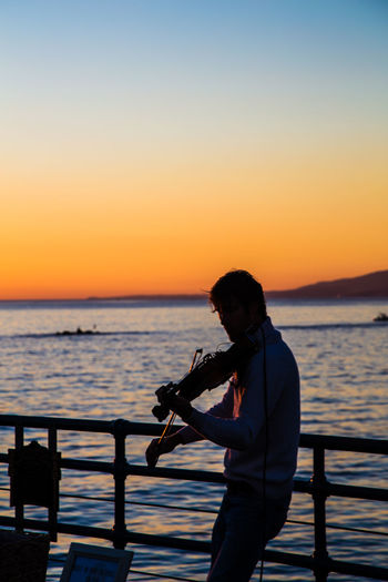Adult Adults Only Beauty In Nature Men Nature One Man Only One Person One Young Man Only Only Men Outdoors People Santa Monica Santa Monica Pier Sea Silhouette Sunset TakeoverMusic Violin Violinist Water Young Adult
