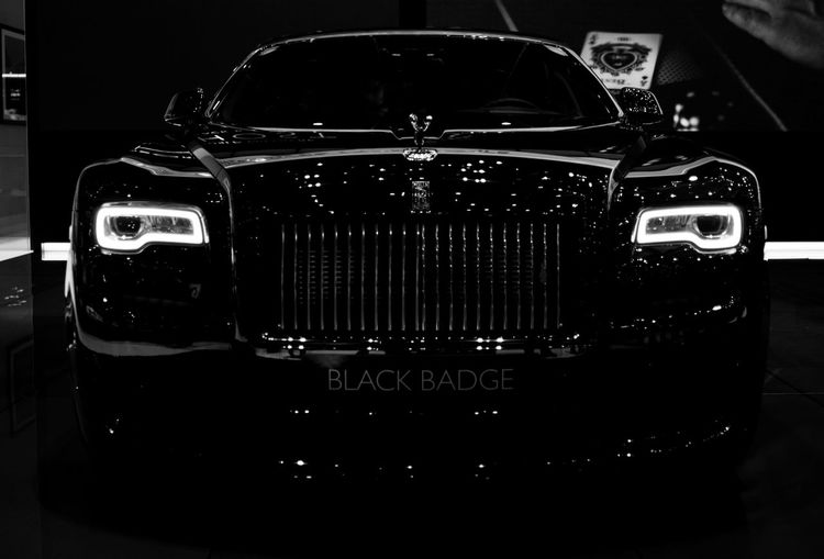 Rolls Royce Ghost Black Badge Auto Show Black Background Blackandwhite Car CarShow Close-up Collector's Car Dark Front View Geneva No People Rolls Royce Rolls Royce Ghost The Drive Transportation Monochrome Photography