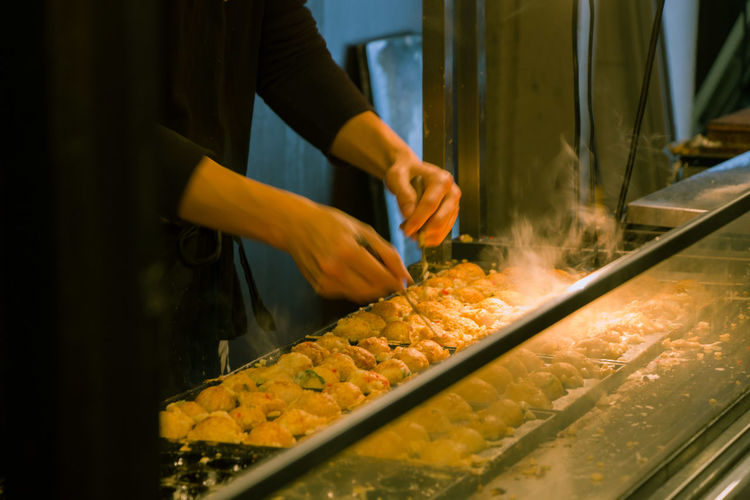 Preparing takoyaki