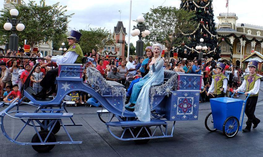 Arts Culture And Entertainment Amusement Park Amusement Park Ride Multi Colored Carousel Outdoors Tree Day People Disney Parade Anna Elsa Frozen Movie Characters
