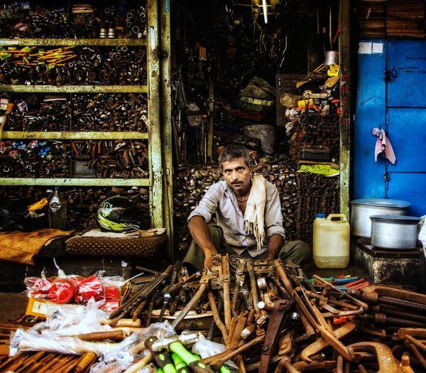 Portrait of man standing in market