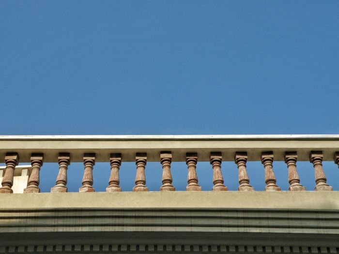 Low Angle View Of Balustrade Against Clear Blue Sky