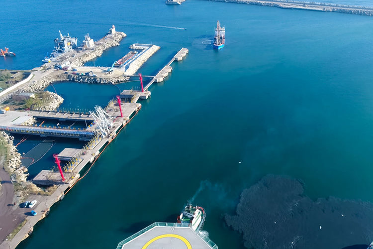Water Sea Nautical Vessel Transportation High Angle View Nature Mode Of Transportation Day Ship Industry Harbor Architecture Aerial View Outdoors Sunlight No People Freight Transportation Blue Shipping  Turquoise Colored
