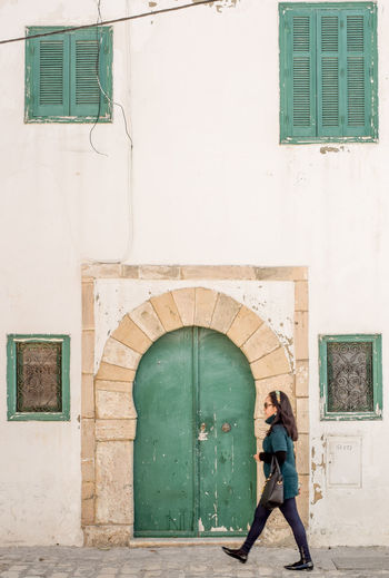 Photo Of The Day Streetphoto_color Eyeemphotography Photograph Tunisialive Tunisiancommunity EyEmNewHere Streetphotography Picoftheday Mahdia/Tunisia Architecture Building Exterior People Green Color Outdoors City One Person Tunisia Doorsandwindows Doors From The Past Windowsaroundtheworld Doors Around The World Doors And Windows Around The World